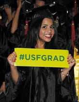 university-of-south-florida-graduate-holding-sign